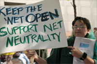 Image: Demonstrator w/Net Neutrality Sign