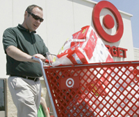 Image: Fairly happy blind shopper with a cart of target goods.